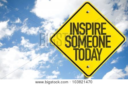 Inspire Someone Today sign with sky background