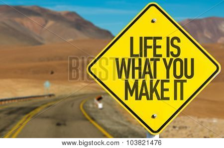 Life Is What You Make It sign on desert road