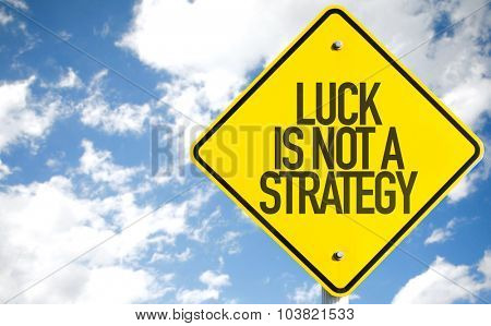 Luck Is Not a Strategy sign with sky background