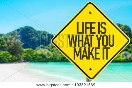 Life Is What You Make It sign with beach background