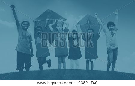 Group of Children Playing Kites Outdoors Concept