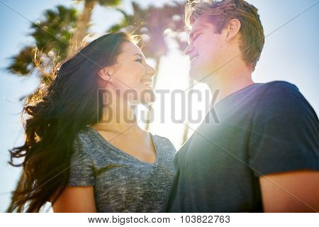 romantic couple looking lovingly at each other on warm sunny day