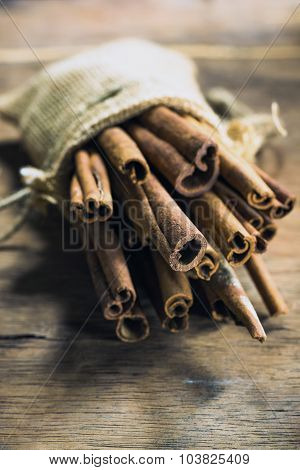 Cinnamon Stick In Gunny Bag On Rustic Wood Table  Background, Still Life Photography With Cinnamon S