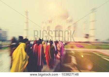 People Walking Through the Taj Mahal Famous Place Concept