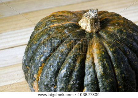Pumpkin close up over wooden background with copy space