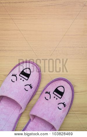 Smile Slippers And Happy, Close Up View, On Wooden Floor