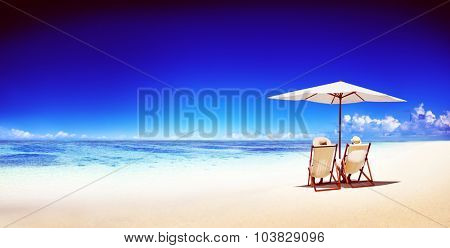 Couple Relaxing Tropical Beach Ocean Summer Travel Concept