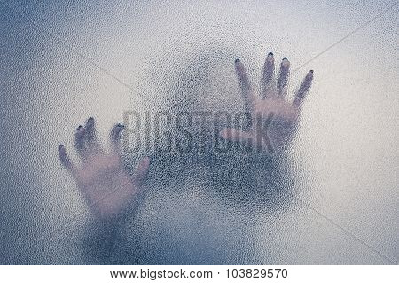 Halloween Female Hand Behind Transparent Glass Background As Silhouette