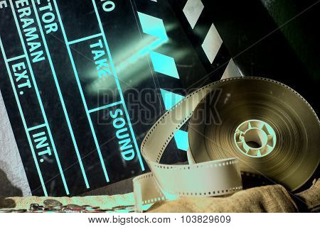 Cinema Clapper And Video Film Negative Movie On A Rough Cloth