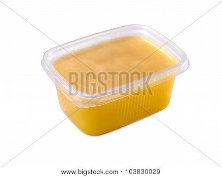 plastic container with ghee butter isolated