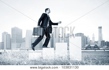 Business Man Climbing Up Steps Outdoors Concept