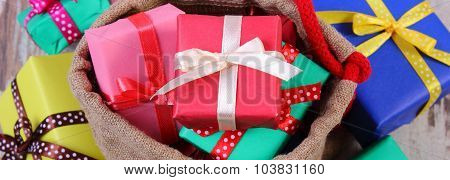 Heap Of Wrapped Gifts For Christmas Or Other Celebration On Old Wooden Plank