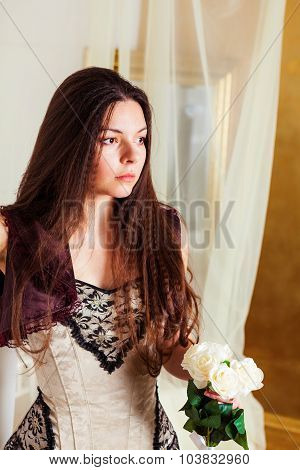 Lovely woman with flowers in hand