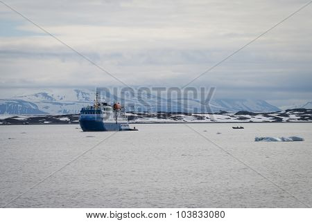 Ship Sailing Between Icebergs In The Arctic Sea In Svalbard