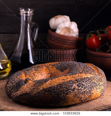 Bagel With Poppy Seeds In Rustic Style.