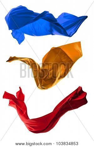Isolated shots of freeze motion of colored transparent silk, isolated on white background