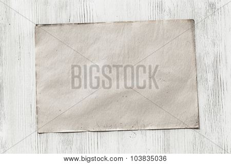 old paper on white wooden background