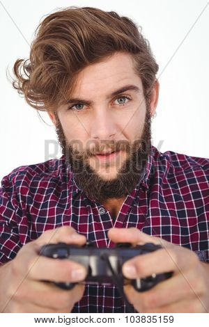 Portrait of hipster playing video game against white background