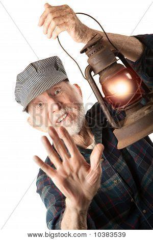 Railroad Man Holding Lantern