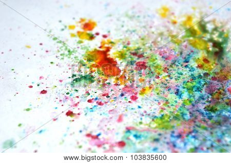 Abstract splashes of watercolor on bluish background