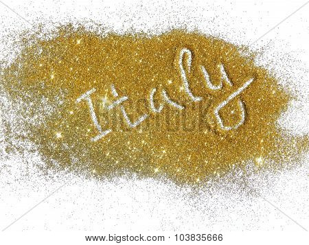 Blurry inscription Italy on golden glitter sparkles on white background