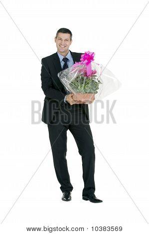 empresario con Jarrón con flores aisladas sobre fondo blanco