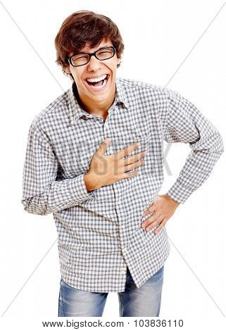 Young hispanic man wearing checkered shirt, blue jeans and black glasses standing with hand on his chest and laughing out loud isolated on white background - humor concept