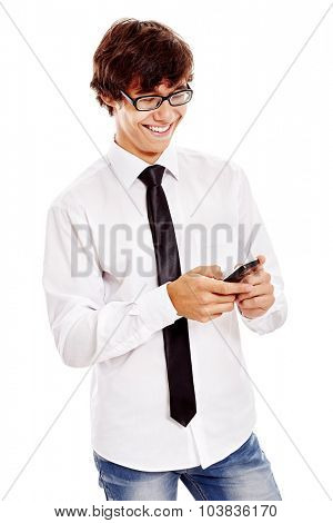 Young hispanic man wearing white shirt, blue jeans, black tie and glasses reading something funny from his mobile phone and laughing isolated on white background - humor and communication concept