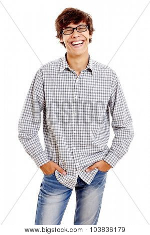 Young hispanic man wearing checkered shirt, blue jeans and black glasses standing with hands in pockets and laughing isolated on white background - humor concept
