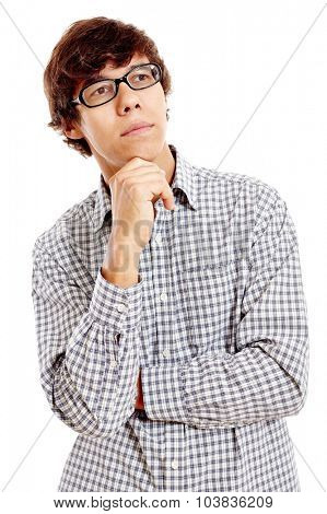 Young hispanic man wearing blue checkered shirt and black glasses standing with hand on his chin and thinking isolated on white background - planning concept