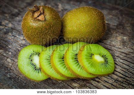 Close Up Fresh Kiwi Fruit On Old Wood Background.
