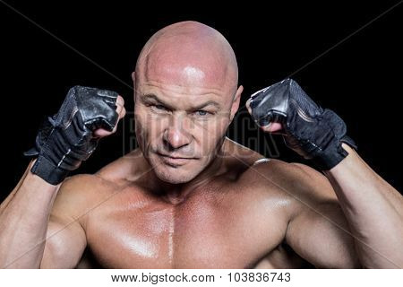 Portrait of fighter in gloves against white background