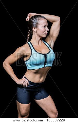 Beautiful woman in sportswear against black background