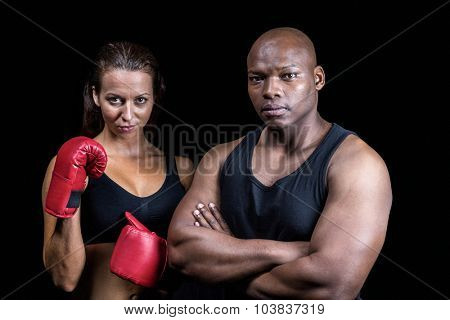 Portrait of athletes standing together against black background