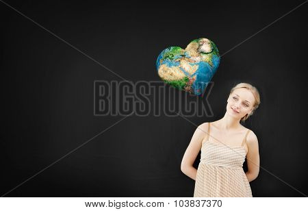 Young pretty woman and heart shaped Earth planet. Elements of this image are furnished by NASA