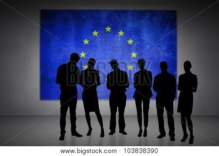 Silhouettes against eu flag