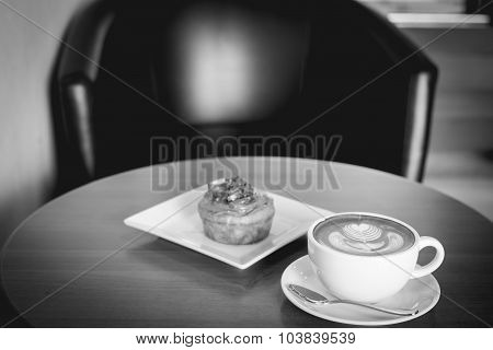 Apple Cinnamon Roll Served With Latte Coffee On The Table At Restaurant Black And White Tone