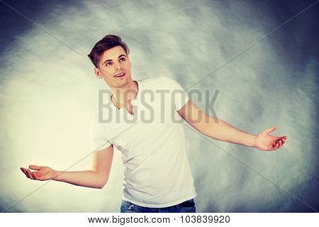 Young handsome man with open hands.
