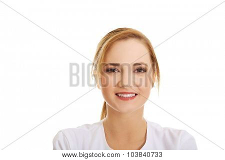 Young female doctor or nurse smiling to camera.