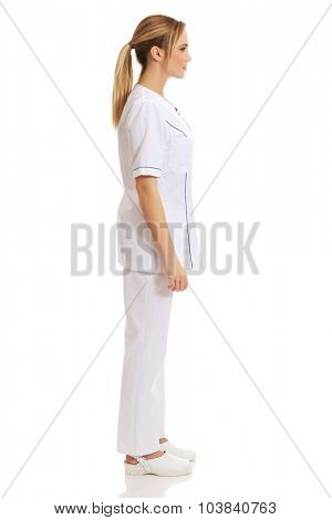 Young female doctor or nurse standing.
