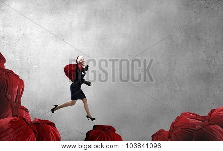 Santa woman running with red gift bag on back