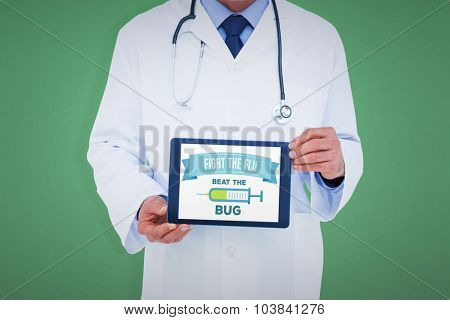 A doctor showing digital tablet against green