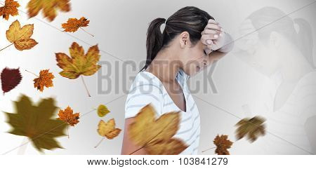 Side view of depressed woman against autumn leaves