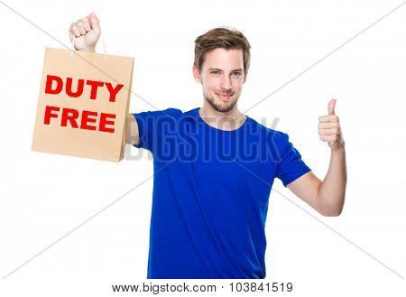 Man with shopping bag and thumb up and showing duty free