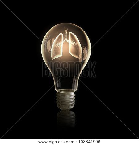 Light bulb with lungs on black bakground