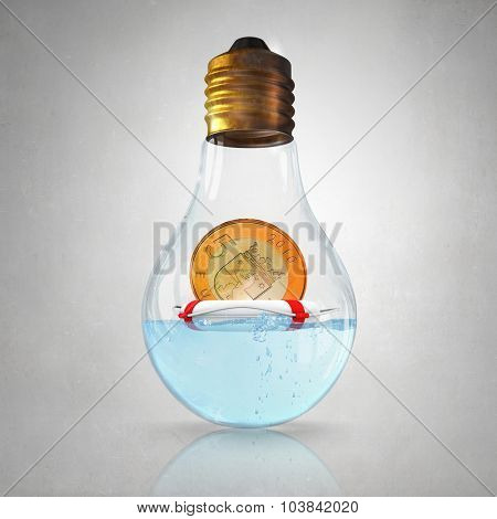 Glass light bulb with euro coin in buoy floating inside