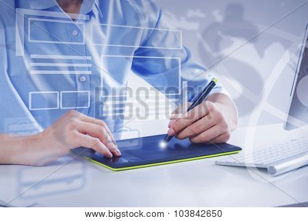 Graphic designer drawing something on tablet at office