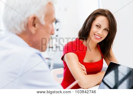Modern business woman sitting in the office