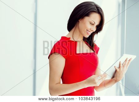 Modern business woman in the office with tablet