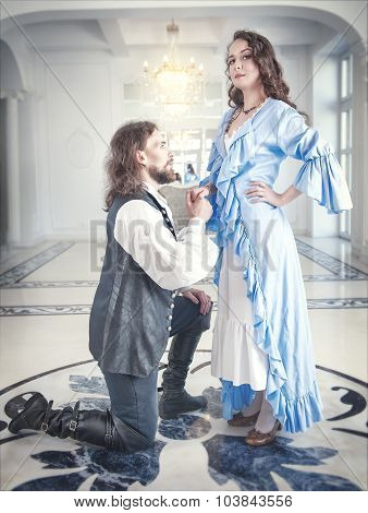 Man In Medieval Costume Standing On The Knee Before Woman
